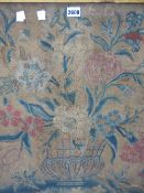 AN EARLY 18th C. SILK AND WOOL NEEDLEWORK PICTURE OF A BLUE AND TURQUOISE FLUTED VASE OF FLOWERS. 55