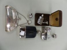 A HALLMARKED SILVER PURSE, TWO SCENT BOTTLES WITH FUNNELS, AND TWO POCKET FLASKS.