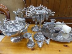 A GROUP OF PLATED CANDLESTANDS, WITH STAG DECORATION ETC.