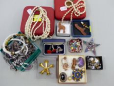 A COLLECTION OF VARIOUS COSTUME JEWELLERY TO INCLUDE BROOCHES, NECKLACES, CUFFLINKS, PEARLS, ETC.
