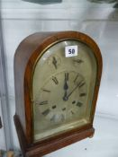 AN OAK CASED THREE TRAIN MANTLE CLOCK.