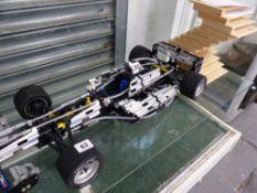 A LEGO TECHNICS RACE CAR, AND A DESIGNER CD RACK.