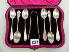 A CASED SET OF HALLMARKED SILVER TEA SPOONS AND SUGAR TONGS.