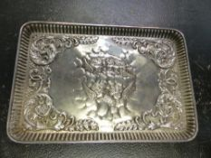 A HALLMARKED SILVER DRESSING TABLE TRAY WITH REPOUSSE DECORATION, TWO DRESSING TABLE JARS, ETC.