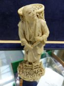 A JAPANESE CARVED IVORY FIGURE DEPICTING A SCHOLAR WITH SIGNED SIGNATURE TABLET TO BASE, TOGETHER