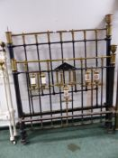 A SET OF PAINTED IRON AND BRASS BED ENDS WITH PORCELAIN DECORATIONS.