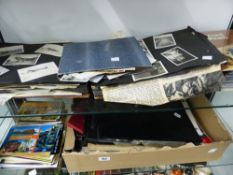 A COLLECTION OF POSTCARDS, PHOTO ALBUMS ETC.