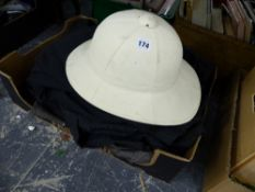 A PITH HELMET, OVER COATS ETC.