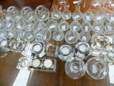 A QUANTITY OF GLASS BUD VASES AND TEA LIGHT STANDS.