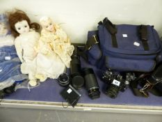 CAMERAS BY ZENIT AND PRAKTICA, VARIOUS LENSES AND THREE BISQUE HEAD DOLLS.