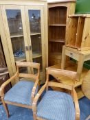 A MODERN OAK DISPLAY CABINET, PINE OCCASIONAL FURNITURE, TWO ARMCHAIRS ETC.