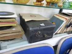 A PORTABLE GRAMOPHONE AND A QUANTITY OF 78 RPM RECORDS.