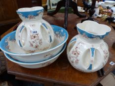 A PAIR OF LATE VICTORIAN ART AND CRAFTS WASH JUG AND BASIN SETS.