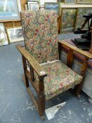 A MORRIS STYLE RECLINING ROCKING CHAIR.