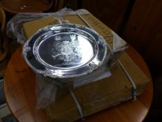A QUANTITY OF SILVER PLATED ARMORIAL PLATTERS.