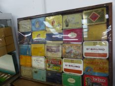 A FRAMED COLLECTION OF CIGARETTE AND TOBACCO TINS.