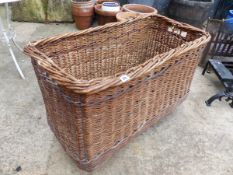 A VINTAGE LOG BASKET.