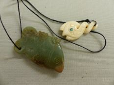 AN ANTIQUE CARVED JADE FISH FORM PENDANT, TOGETHER WITH A LATER SOUTH SEA PENDANT.