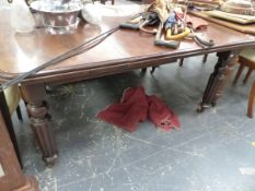 A VICTORIAN MAHOGANY EXTENDING DINING TABLE.
