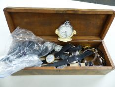 A QUANTITY OF VARIOUS WRIST WATCHES CONTAINED IN A ORIENTAL CARVED TIGER BOX.