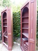 A PAIR OF LARGE BESPOKE MAHOGANY CORNER DRINKS CABINETS WITH PANELLED DOORS.