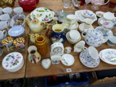 A QUANTITY OF VARIOUS VINTAGE TEA WARES, WADE WHIMSIES, AND DENBY MUGS.