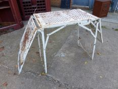 AN UNUSUAL PAINTED WROUGHT IRON FOLDING TABLE.