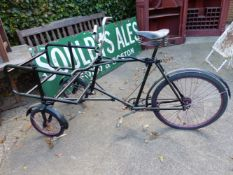 A VINTAGE DELIVERY BICYCLE.