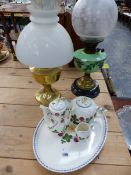 A VICTORIAN OIL LAMP, A LATER PARAFFIN LAMP, AND A COPENHAGEN PART TEA SERVICE ON TRAY.