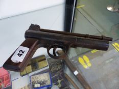 AN EARLY WEBLEY AND SCOTT AIR PISTOL.