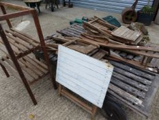 TWO GARDEN LOUNGERS, STACKING CHAIRS, A POTTING STAND ETC.