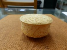AN UNUSUAL IVORY CARVED BOX AND COVER, AN IVORY HAND PART BACK SCRATCHER, A BONE SEAL ETC.