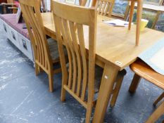 AN OAK EXTENDING TABLE AND CHAIRS.