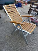 A FOLDING PATIO CHAIR.