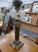 A VICTORIAN FOUR COLUMN OIL LAMP.
