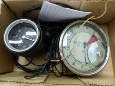 A VOLVO DASH MOUNTED REV COUNTER AND AN S SMITH AND SONS REV COUNTER.