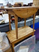 A SMALL ANTIQUE PINE DROP LEAF TABLE AND A KITCHEN WORK UNIT.