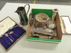 A PART SET OF SILVER COFFEE SPOONS AND TONGS, A SILVER CANDLESTICK, A PLATED TRAY, A BUTTER DISH,