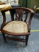 A LATE VICTORIAN DESK CHAIR WITH CANE SEAT.