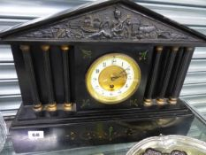 A LARGE VICTORIAN BLACK SLATE MANTLE CLOCK.