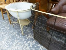 A VICTORIAN NURSERY FIREGUARD TOGETHER WITH A VINTAGE BABY BATH ON STAND.