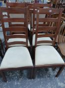 A SET OF MODERN LADDER BACK SIDE CHAIRS.