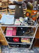 A VINTAGE STEEL FOUR TIER WORK TABLE, MOTORCAR RELATED TOOLS, AA BADGES, OIL CANS ETC.