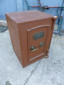 A VINTAGE CAST IRON SAFE.