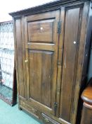 AN 18th C. OAK HALL CABINET.