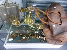 A QUANTITY OF VINTAGE BRASS LIGHTING AND A LEATHER HOLDALL.