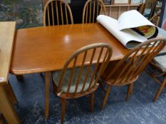 ERCOL ELM DINING TABLE, TWO ERCOL ARM CHAIRS, AND SIX SIMILAR SPINDLE BACK CHAIRS.