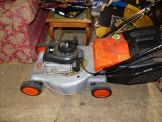 A FLYMO LAWN MOWER WITH BRIGGS & STRATTON PETROL ENGINE.