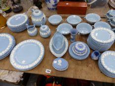 A WEDGEWOOD EMBOSSED QUEENS WARE PART TEA SERVICE. COMPRISING OF TEN TEA CUPS, SEVEN TEA SAUCERS,