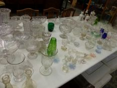 A LARGE COLLECTION OF VICTORIAN AND LATER PRESSED AND CUT GLASS VASES, SALTS, BOWLS ETC.